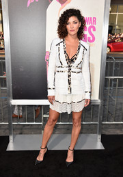 Jessica Szohr showed some cleavage in a white Diane von Furstenberg mini dress with a lace hem and leopard-print trim during the 'War Dogs' premiere.