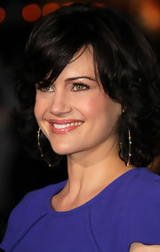 Actress Carla Gugino attended the premiere of 'The Rite' wearing 14-karat gold large Blake earrings with diamonds.