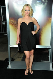 Marley Shelton paired her draped cocktail dress with 18-karat gold bangles with diamonds.