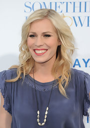 Natasha Bedingfield attended the premiere of 'Something Borrowed' wearing shimmery muted coral-pink lipstick.