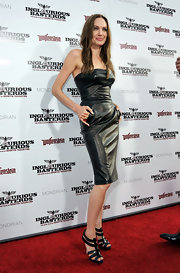 Angelina Jolie paired her strapless leather dress with strappy sandals.