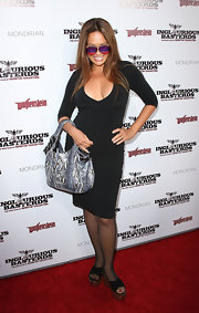 Tia Carrere opted for comfy footwear with these chunky cross-strap wedges.