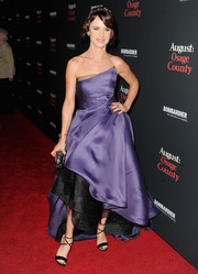 Juliette Lewis channeled her inner princess at the 'August: Osage County' premiere in a purple strapless gown by Monique Lhuillier, featuring a flouncy skirt with a black petticoat.