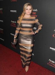 Abigail Breslin was a head turner in a figure-hugging gold striped dress by Norma Kamali at the 'August: Osage County' LA premiere.