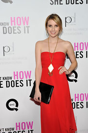 To recreate Emma Roberts' look, her stylist recommends applying KeSARI Indian Oil Hair Serum to clean, dry hair. Then, take large sections and wrap hair around a 1.25 inch curling iron to add texture and volume. Secure a loose ponytail at the nape, leaving out a one inch section. Finally, wrap ponytail in a hair elastic, finally twisting extra piece around ponytail. The hair ends can be secured with a bobby pin.