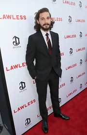 Shia LaBeouf attended the premiere of 'Lawless' looking elegant in a black suit and striped red tie.