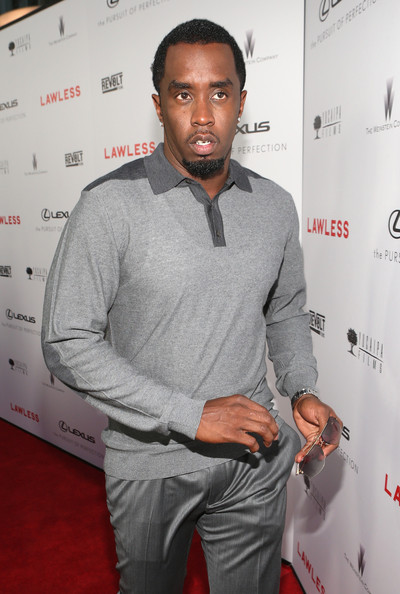 Sean Combs matched a gray sweatshirt with formal slacks for his red carpet look during the premiere of 'Lawless.'