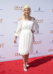 Tori Spelling looked angelic in a white cold-shoulder midi dress at the premiere of 'Leap!'