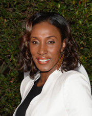 Lisa Leslie wore ultra-feminine curls when she attended the 'Mandela: Long Walk to Freedom' Hollywood premiere.