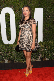 Shaunie O'Neal teamed yellow and orange peep-toes with her dress for a pop of color.