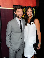 Naomi Scott posed with her husband as she attended a movie premiere wearing a chic white dress.
