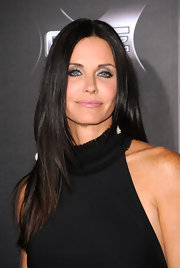 Courtney Cox loves to keep her tresses sleek and polished. At the 'Scream 4' premiere she opted for a center part straight cut.