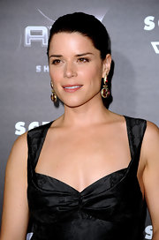 Neve Campbell paired her sleek ponytail with radiant gemstone earrings. Ruby and gold hues were the perfect way to accent her black cocktail dress.