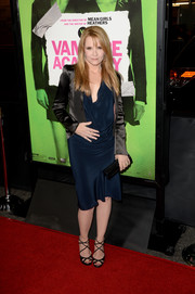 Lea Thompson layered a cropped black satin jacket over a blue cocktail dress for her 'Vampire Academy' premiere look.