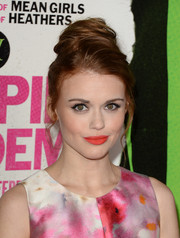 Holland Roden highlighted her pout with some bright red lipstick.