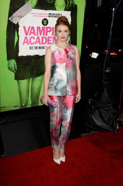 Holland Roden continued the watercolor theme with a pink and purple tube clutch by Amanda Pearl.