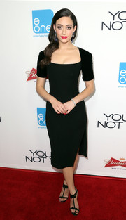 A pair of bow-adorned Jimmy Choo T-strap sandals added some sweetness to Emmy Rossum's look.