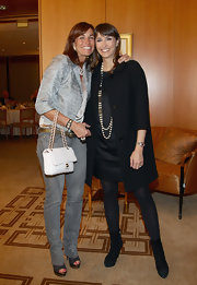 Cristina Parodi broke out her pristine white Chanel purse as she attended a cocktail for Premio E' Giornalismo.