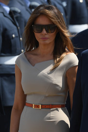 Melania Trump gave her taupe dress a pop of color with an orange skinny belt.