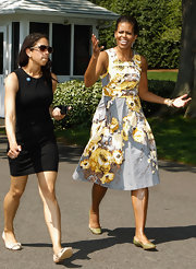 Michelle Obama paired olive ballet flats with a floral dress for an easy-breezy spring look.