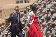 Michelle Obama looked oh-so-sweet in an embroidered cardigan layered over a red dress during a visit to Fort Stewart.