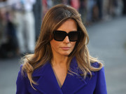 Melania Trump kept her eyes hidden behind a pair of oversized square shades.