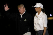 Melania Trump returned to the White House from Florida looking casual in a USA baseball cap.