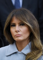 Melania Trump wore her signature feathered flip at the welcome ceremony for Israeli Prime Minister Benjamin Netanhayu.