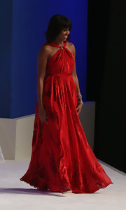 Michelle was a vision at the inaugural ball in this red sweeping gown.