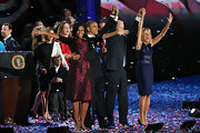 Michelle Obama shimmered in a burgundy cocktail dress during President Obama's election night event.