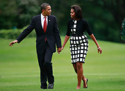 Out on a day with her husband, Mrs. Obama shows off her waist line in a Liz Claiborne dress with a belt.
