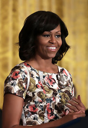 Michelle Obama complemented her floral dress with a curly 'do for an ultra-feminine finish during a veterans employment event at the White House.
