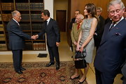Carla held her versatile black shoulder bag. The purse was a classic choice for the French first lady.