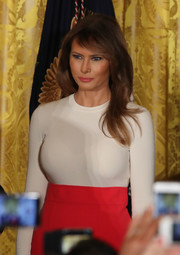 Melania Trump paired a fitted white crewneck sweater with a high-waisted red skirt for the Hispanic Heritage Month event at the White House.