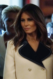 Melania Trump wore her signature center-parted style while attending a reception for the President of Poland.
