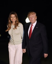 Melania Trump stayed comfy in a mint-green cardigan while returning to the White House after her trip to Saudi Arabia.
