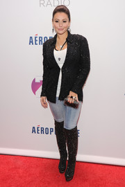 Jenni Farley glammed up her jeans and tank top combo with a beaded black blazer when she attended Jingle Ball.