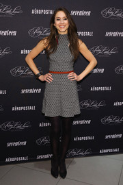 Troian Bellisario went for a retro vibe with this micro-print mini dress during the 'Pretty Little Liars' fashion launch.
