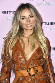 Erica Pelosini wore her long hair down in piecey waves when she attended the PrettyLittleThing x Olivia Culpo launch.