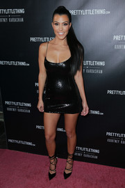 Kourtney Kardashian amped up the sex appeal with a pair of black multi-strap pumps.