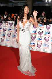 Nicole Scherzinger showed off her fabulous figure in a white Zahavit Tshuba gown, featuring mesh-patterned silver beading, a low neckline, and a body-con silhouette, at the 2017 Pride of Britain Awards.