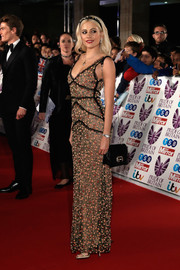 Pixie Lott paired her dress with a black suede shoulder bag.