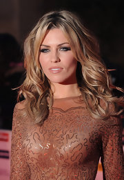 Abbey lets her hair down with this layered and wavy hairstyle.