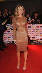 Abbey Clancy oozed sultry sophistication in this beaded sheer dress at the Pride of Britain Awards.