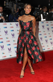 Alesha Dixon showed off her ultra-feminine style at the Pride of Britain Awards with this high-slit rose-print strapless dress from her collection for Little Black Dress.