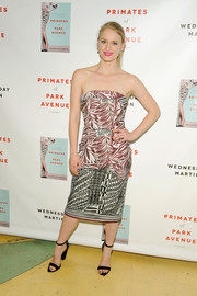 Leven Rambin attended the 'Primates of Park Avenue' release event wearing a chic mixed-print strapless dress by Christian Siriano.