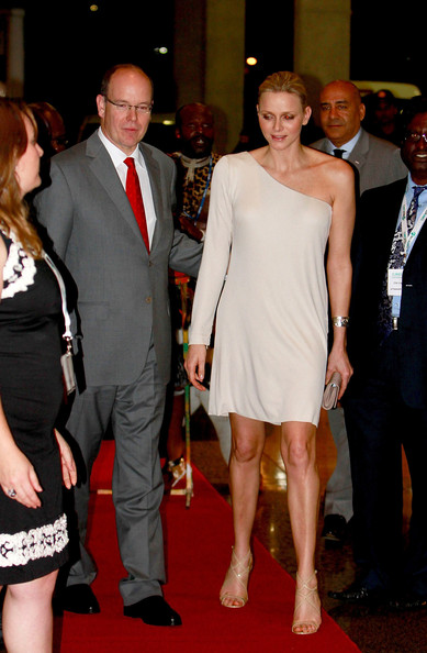 Princess Charlene of Monaco attended the One Billion Tree Campaign Gala wearing a sleek ivory one shoulder dress with strappy nude sandals.
