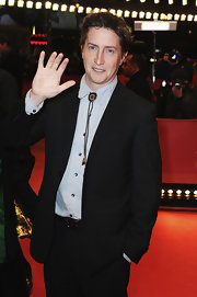 David Gordon Green chose a Southwestern-inspired bolo tie with a gemstone design for his red carpet look.