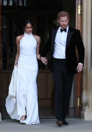 Meghan Markle changed out of her wedding dress into this white halter gown by Stella McCartney for an evening reception hosted by the Prince of Wales.
