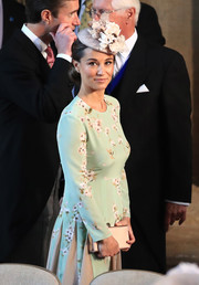 Pippa Middleton paired a gold satin clutch with a floral frock for Prince Harry and Meghan Markle's wedding.